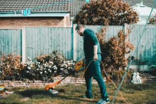 man mowing the yard