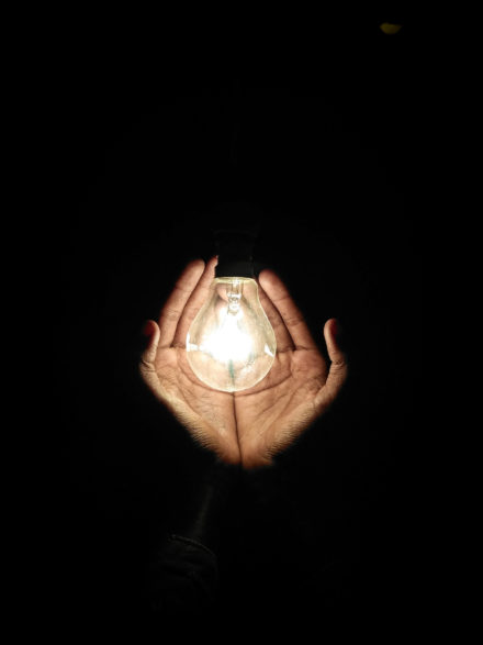 Hands and lightbulb